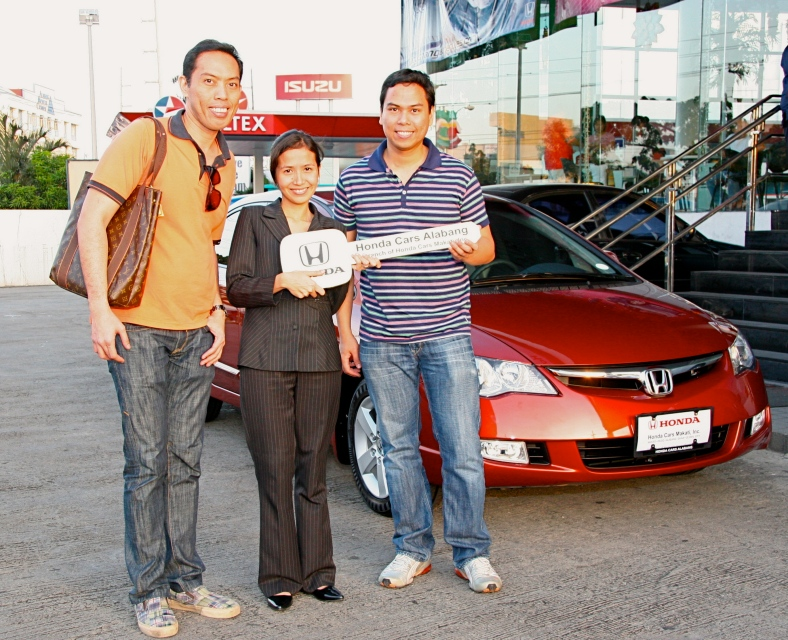 MY US-based brother Ronnie and I the day we drove off with my then new Honda Civic in December 2008. For some reason, I can't find a picture of my first ever car, a deep teal Toyota Corona sans power steering, windows and locks.