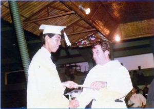 A MONTH after Pope John Paul II's February 1981 visit, all the banderitas were gone, but the makeshift stage with a wooden canopy on the grandstand was retained. As far as I know, we're the first and so far only UST High School batch who graduated outdoors and on hallowed grounds. alexyvergara receives his high school diploma from movie star-handsome Fr. Escudero.