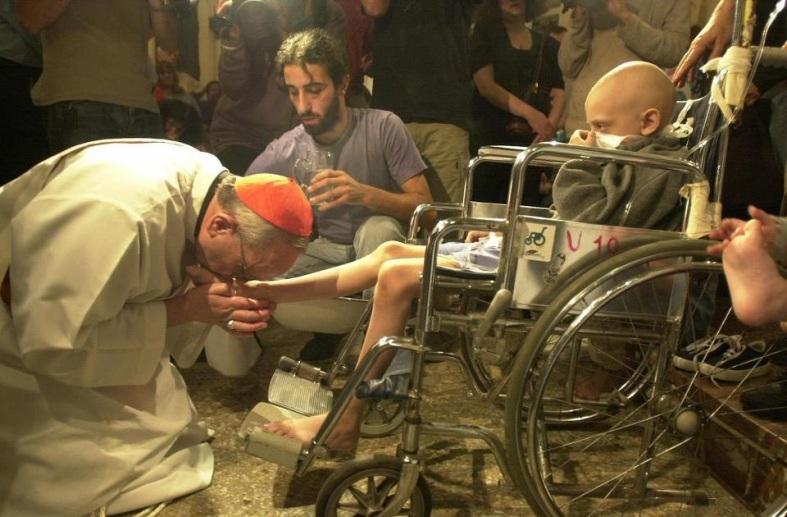 THEN Archbishop Jorge Cardinal Bergoglio of Buenos Aires attends to the sick and marginalized of his flock. (www.dallasvoice.com)