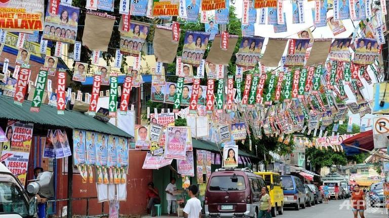 FILIPINOS go through elections with fiesta-like fervor. (www.channelnewsasia.com)