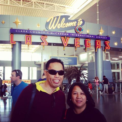 LAI and I, after more than a day of traveling, arrive at the Las Vegas international airport.