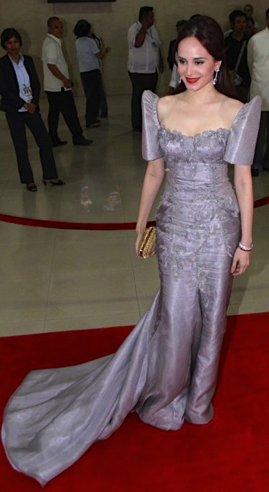 ALTHOUGH she could probably get away in almost any look, Gomez has saved the bling for showbiz events and went classic.