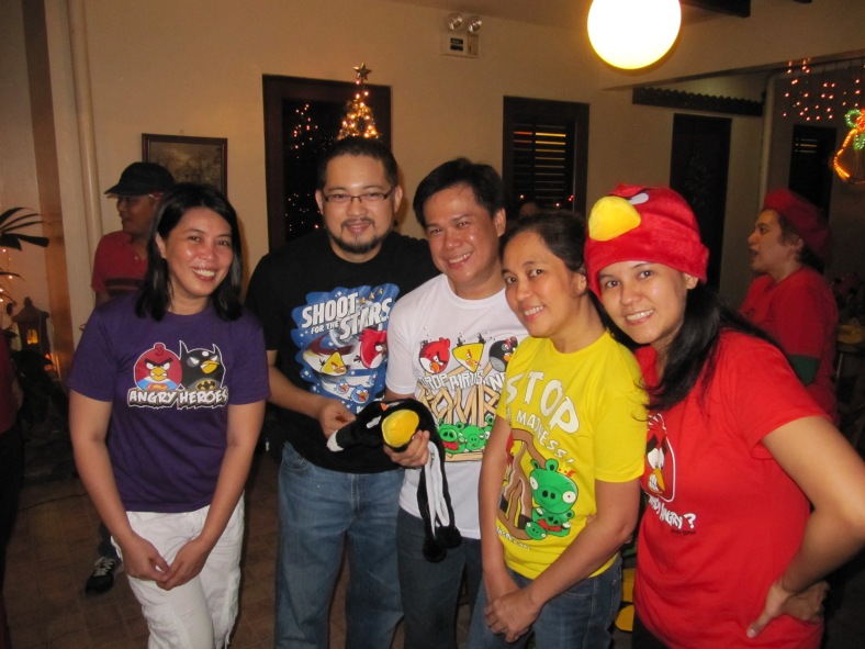 LEAH, with members of the gang, during a Christmas party in 2012.