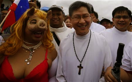 WHEN Miss Piggy and Archbishop Luis Antonio Cardinal Tagle cross paths at the anti-pork barrel rally at Luneta.