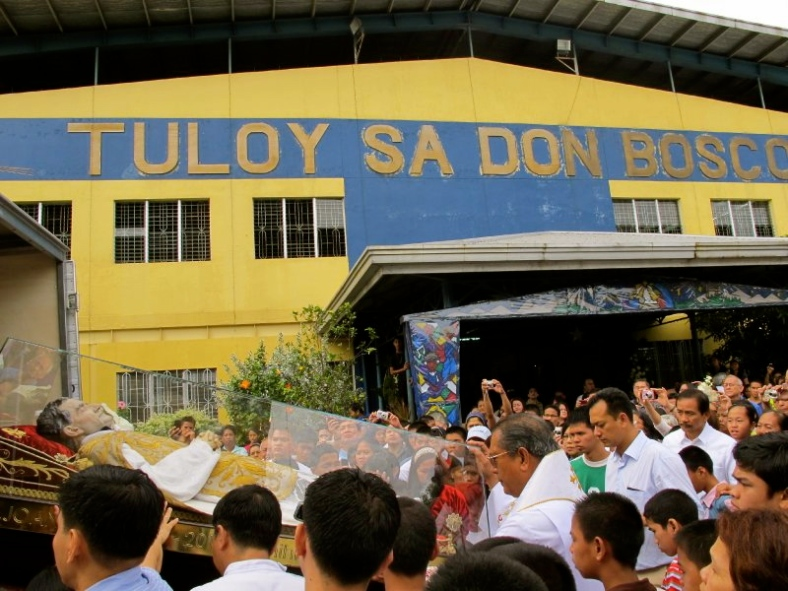 TULOY community bear witness to their Catholic faith as they pay homage to a relic of St. John Bosco, the order's founder.