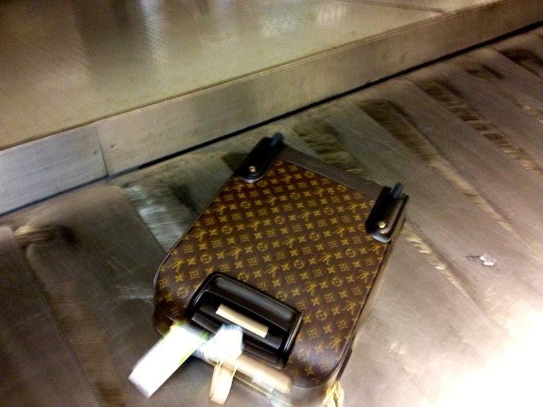 MY checked-in LV roller miraculously survives the flight between Amsterdam and Rome without a scratch.