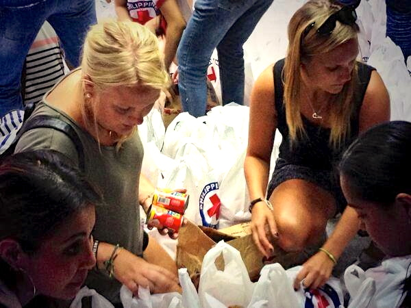 EVEN tourists experienced a different, more meaningful holiday in the Philippines by joining relief efforts (Ivy Lisa Mendoza)