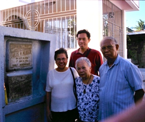 MY PARENTS and I with my late grandmother visit the grave of my Tita Ching