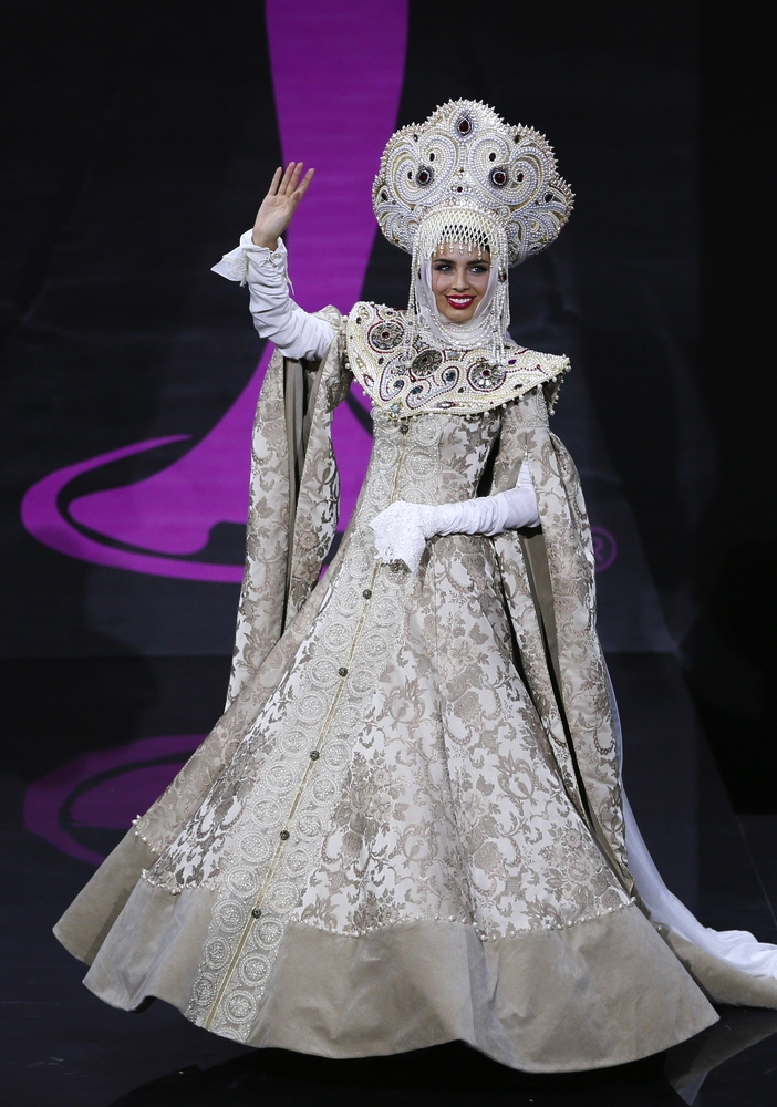 THE heavy details dwarf the petite Miss Russia, but the look is certainly iconic and reminiscent of the vast country's imperial past.
