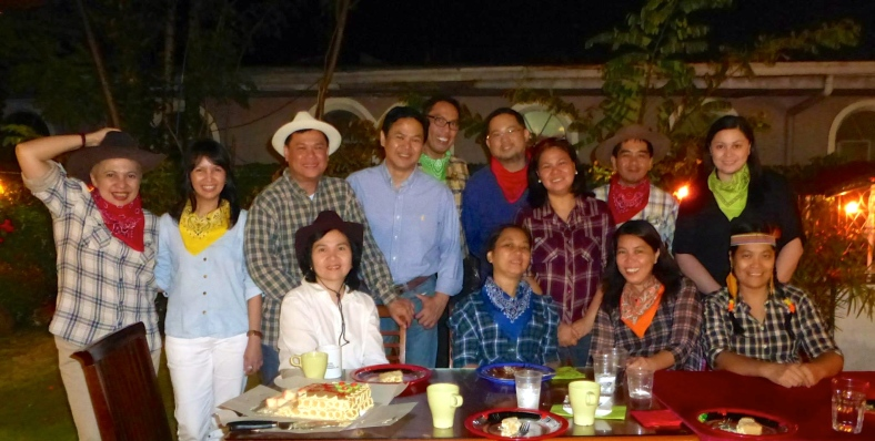THE entire posse in a Western-style powwow complete with Dinuguan, Kare-Kare, Leche Flan and Relyenong Bangus.