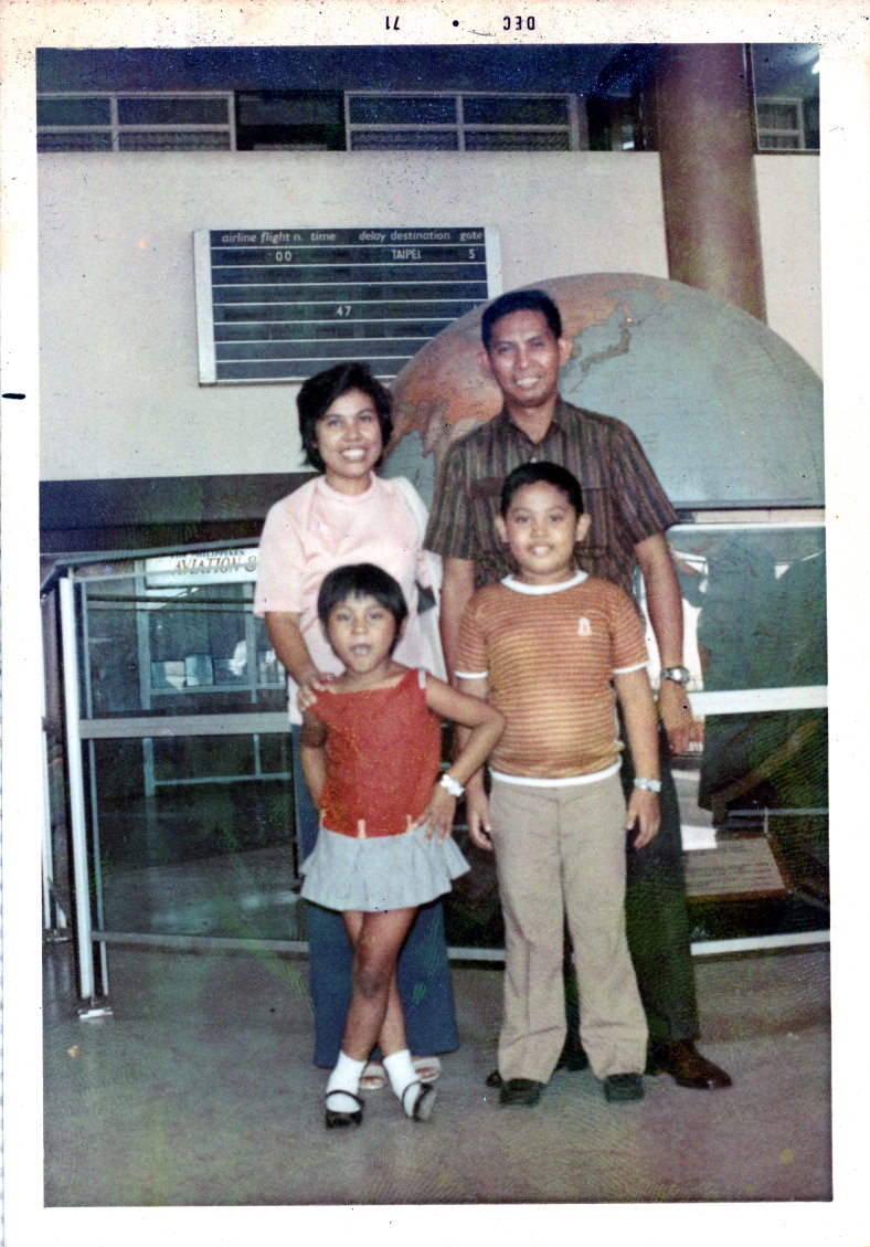A MUCH later photo of the family taken at the same airport. Yeah, I was fat back then. Don't ask me what happened. :-)