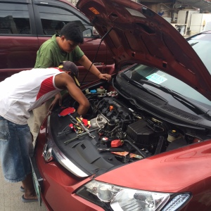 "MECHANICS at ""Sofia Street,"" Bacoor's version of Banawe, replaces my car's busted alternator with a new one."